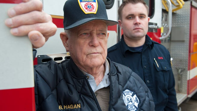 Bill Hagan, Sr., President of Gloucester Heights Fire Association and 60-year veteran with the Gloucester City Fire Department, with his grandson Patrick Hagan, Gloucester City Fire Marshall. Thursday, January 22, 2015.
