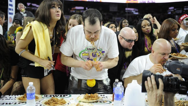 Patrick Bertoletti eats enroute to victory at 94WIP's Wing Bowl 23 held at the Wells Fargo Center in Philadelphia. Friday, January 30, 2015.