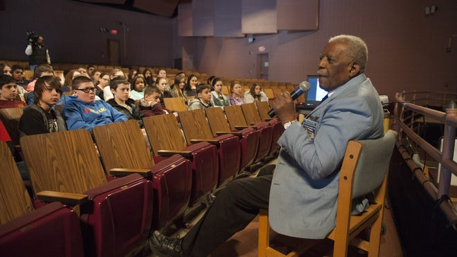 Dr. Eugene Richardson shares his story of the Tuskegee Airmen with students and teachers at Harrington Middle School in Mount Laurel. Thursday, February 19, 2015.