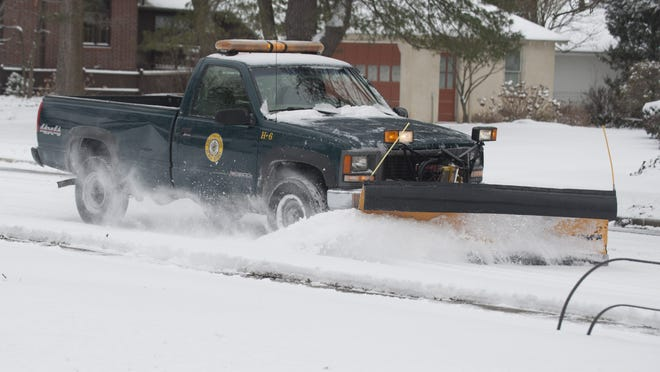 A public works plow truck clears a road in Collingswood in March 2014. Snow has been less frquent this season, but it's catching up: Another storm is headed our way.
