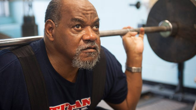 Powerlifter Charles King, a blind and formerly homeless veteran, works out at the Carousel House in Philadelphia. King is trying to fundraise his way to the International Blind Sports Association's World Games in South Korea in May.