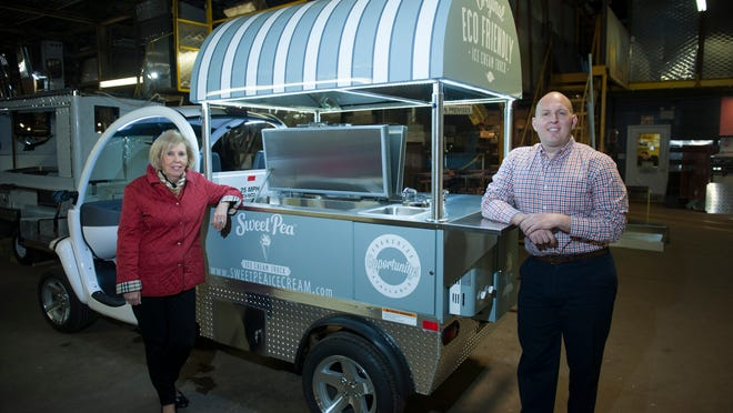 Lynda Sikora, V.P. at Custom Mobile Food Equipment in Hammonton, and her son, David Kyle, director of sales and marketing, stand by a mobile ice cream cart on April 1. The cart will soon hit the streets of Philadelphia.
