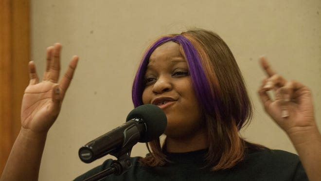 Sade Ford recites a poem at Rutgers University-Camden during a Louder Than A Bomb event, a nationwide poetry slam event that was initiated in Chicago.