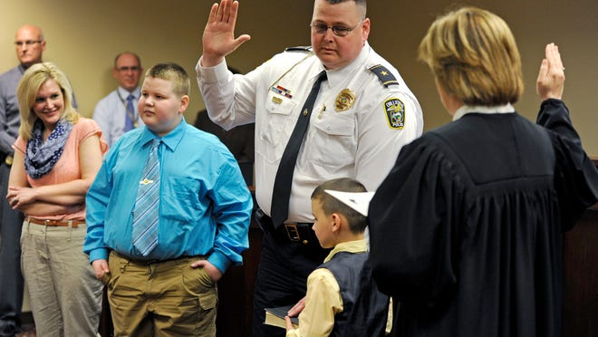In April 2015, Chillicothe Police Chief Keith Washburn was sworn into office at Chillicothe Municipal Court. Standing up with Washburn during his swearing-in ceremony are his family, from left, Stephanie Washburn, Nicholas Washburn and Nathaniel Washburn.