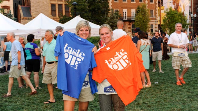 The first Taste of OTR brought together neighborhood restaurants, food trucks and more vendors at Washington Park to benefit Tender Mercies. Mary and Taylor Gelhausen sell tee-shirts to help raise money for Tender Mercies.