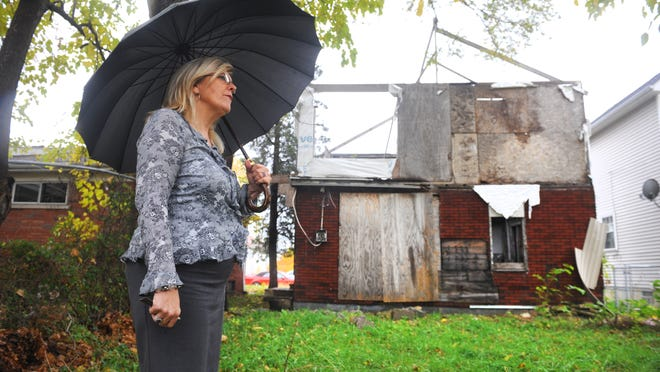 Kathy Angerer, director of community and economic development for Hamtramck, says a count of blighted properties, such as one on Yemens, is key to change.