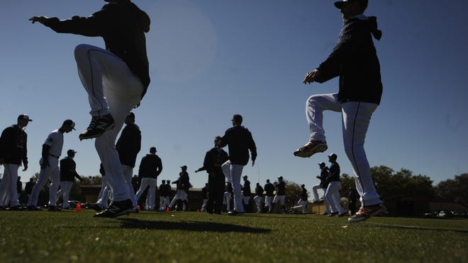 Tigers pitchers and catchers stretch Friday at spring training in Lakeland, Florida.