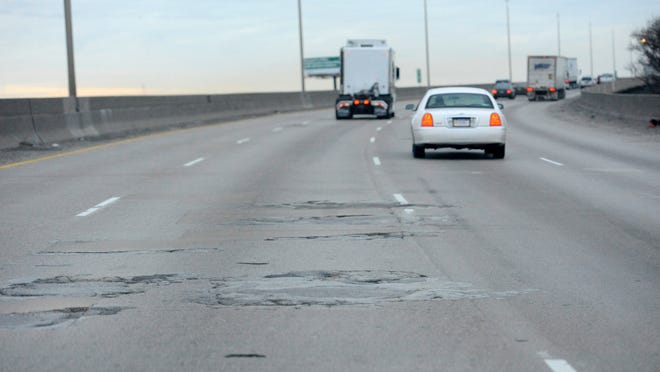 Above: Potholes are visible Monday on the I-75 bridge that carries about 115,000 vehicles a day over the Rouge River.