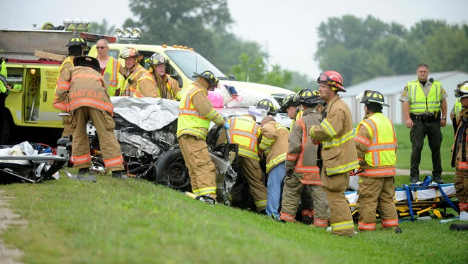 Rescue workers from the Waupun Country Fire Department, with help from Oakfield and Brandon Fire Departments work to extricate the driver from a vehicle involved in a head-on collision south of Waupun on Aug. 23.