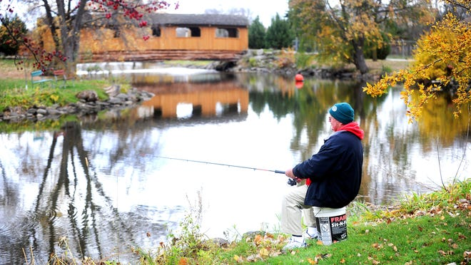 Joe Pflum of Fond du Lac fishes in Lakeside Park in this October 2014 photo. Fishing is a popular activity in the park.