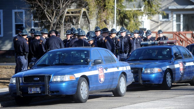 Wisconsin State Patrol officers gather in Kiel Monday, March 30, before the funeral for slain Trooper Trevor Casper. The officer was killed in a shootout with a bank robbery suspect in Fond du Lac on March 24.