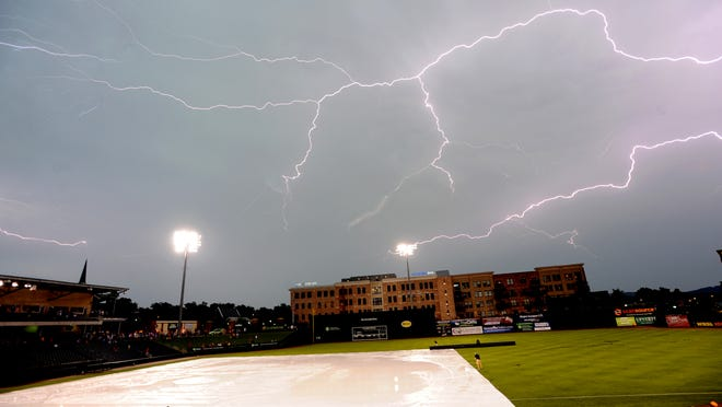 Lightning strikes over Fluor Field at the West End after a severe thunder storm hit the area last year.