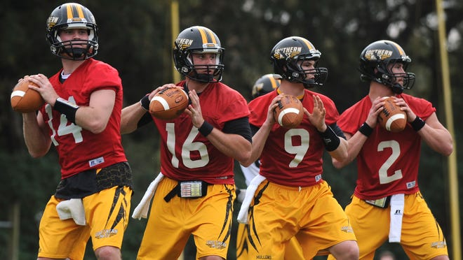 Southern Miss quarterbacks throw passes Tuesday during practice at the Joe P. Park Practice Facility.