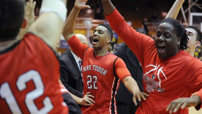 Trevon Bluiett, center, celebrates with teammates after the win. Park Tudor defeated Clarksville 76-64 at the Seymour 2A semi-state Saturday March 22, 2014.