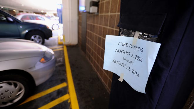 A pay station that is part of a $545,000 parking system installed at Lansing Community College last year sits covered. Picture taken Monday 9/8/2014. (Lansing State Journal | Rod Sanford)