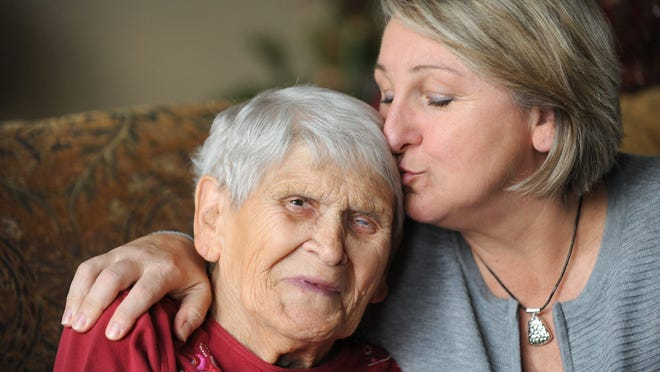 Nina Grigg gets a hug and a kiss from her daughter Linda Grigg Gerdes. Nina served time in a Nazi slave labor camp during World War II.