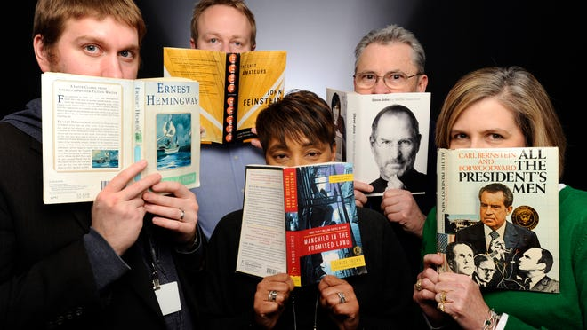 Lansing State Journal staffers, from left, Justin Hinkley, Graham Couch, Vickki Dozier, Steve Reed and JoAnn Klein show off their favorite books.
