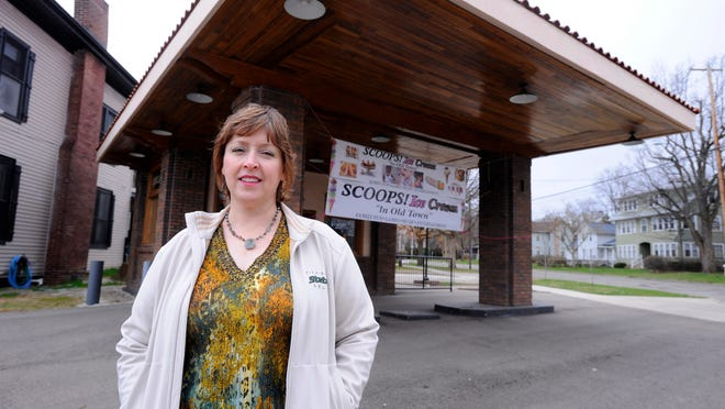 Linda Baughman, owner of soon-to-be-opened Scoops Ice Cream in Lansing's Old Town neighborhood, stands outside the building. Baughman and Rico Lewis, her boyfriend and business partner, plan to open Scoops in the historic former Sinclair gas station.