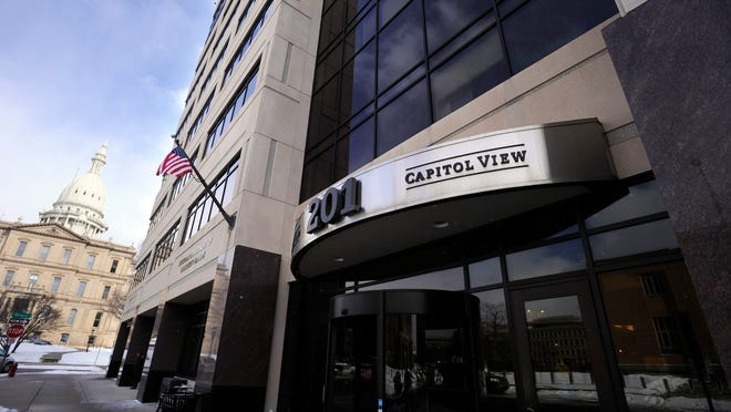 The exterior of the Capitol View Building in downtown Lansing, right, is seen in this State Journal file photo.