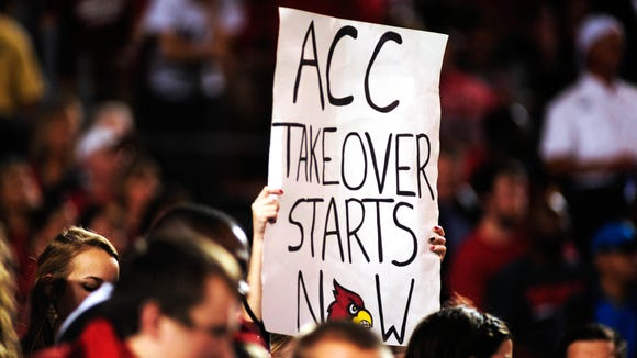 A U of L fan with a sign at the Russell Athletic Bowl was already looking foward to the Cardinals joining the ACC.
