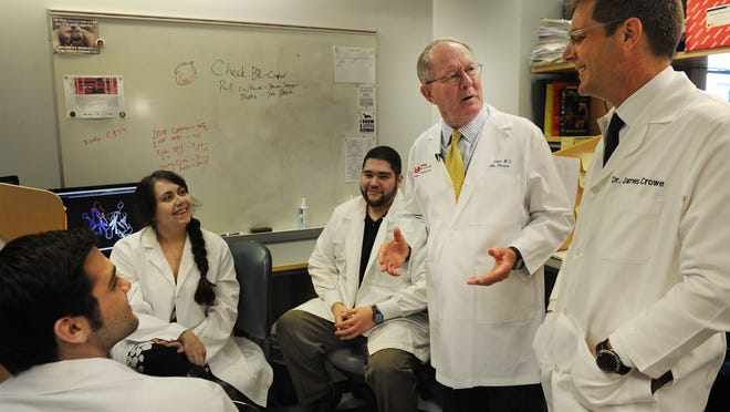 U.S. Sen. Lamar Alexander talks with Dr. James Crowe and other doctors at the infectious disease lab at Vanderbilt.