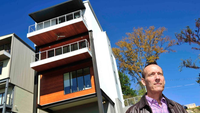 """Attorney Michael Bassham's new modern house in Shelby Bottoms offers amazing views. """"I can almost see Alabama,"""" he said."""