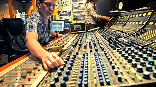 Engineer Brett Lind, left, and assistant engineer Bryce Roberts prepare for an afternoon session in Quad Studios in Nashville.