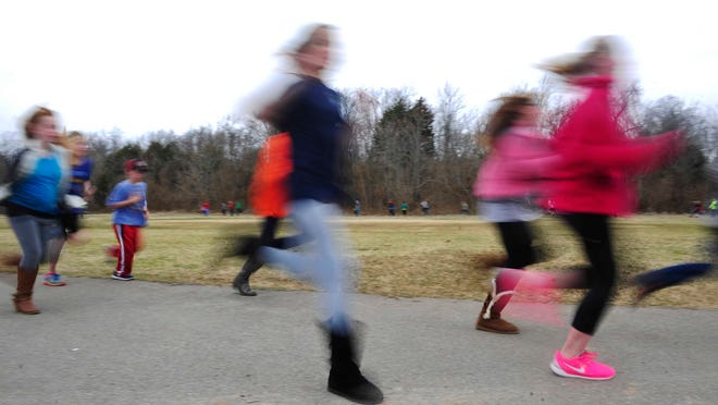 Hundreds of students train for the YMCA of Middle Tennessee's Kids Rock one-mile fun run Monday at Edmondson Elementary in Brentwood.