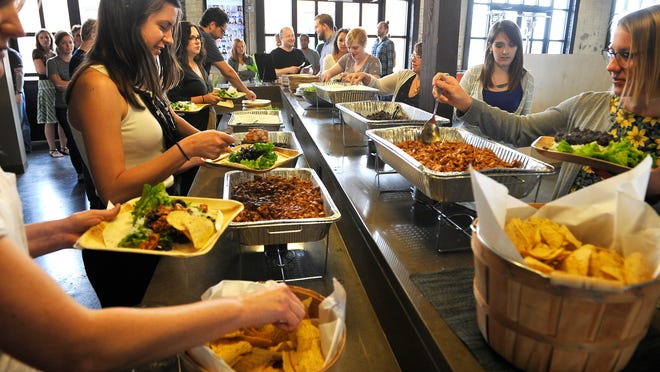 Emma employees enjoy lunch catered to their offices every Wednesday in downtown Nashville. New pop-up food service Sifted caters to tech companies looking to use food as an attractive perk in bringing new talent to Nashville.