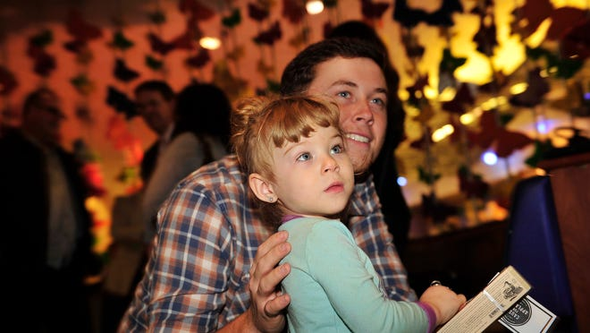 Scotty McCreery is pictured with Harmony Schuver, 2, after performing Tuesday at Monroe Carell Jr. Children's Hospital at Vanderbilt in Nashville.