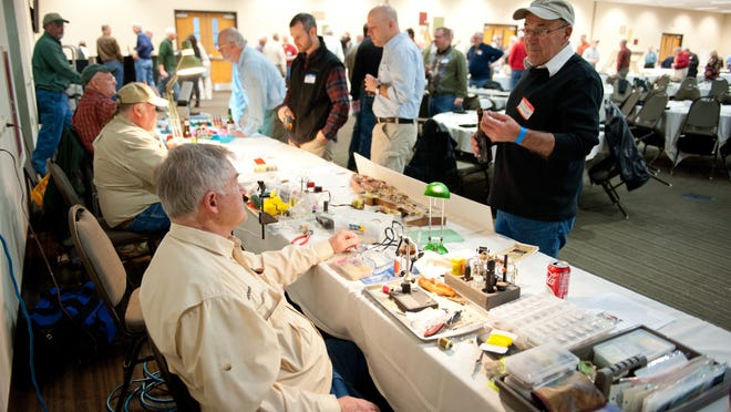 People check out the tables around last year's Wisconsin Trout Unlimited State Council Banquet in Oshkosh. Trout Unlimited is holding TroutFest in Winneconne Feb. 24.