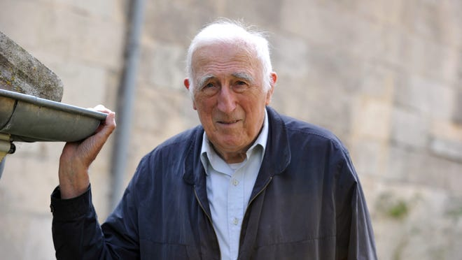 Jean Vanier, 86, poses at home in Trosly-Breuil, France, in September. The association dedicated to handicapped people celebrated its 50th birthday with festive events in Paris on Sept. 27.