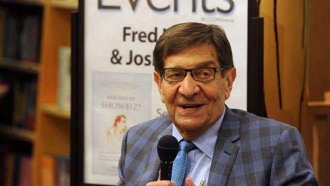 Attorney Fred Levin chats with the crowd about his new book, And Give Up Showbiz? Saturday, during a book signing at Barnes and Noble.