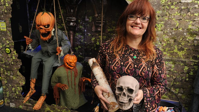 Sue Spencer, Spirit Halloween Stores district manager, poses at the Pensacola store.
