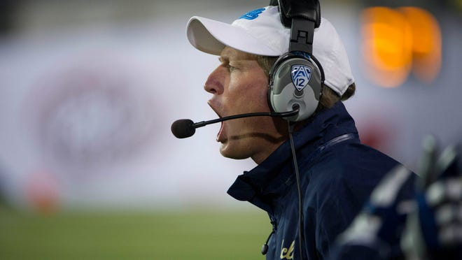 Dec 02, 2011; Eugene, OR, USA; UCLA Bruins head coach Rick Neuheisel against the Oregon Ducks during the second half of the Pac-12 Championship game at Autzen Stadium. The Ducks beat the Bruins 49-31. Mandatory Credit: Jim Z. Rider-USA TODAY Sports