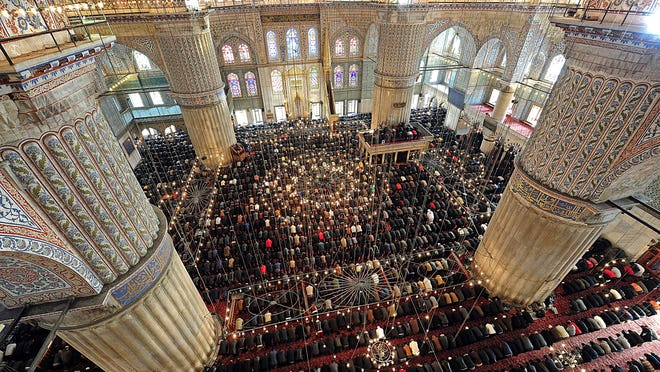 People pray on Friday at the Blue Mosque in Istanbul. Pope Francis is visiting Turkey eight years after his predecessor, Benedict XVI, made a landmark visit to the predominantly Muslim country.