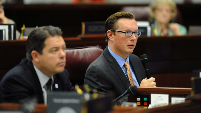 State Sen. Ben Kieckhefer, R-Reno, right, has introduced a bill to mandate Reno and Washoe County broker an automatic aid agreement for fire services.