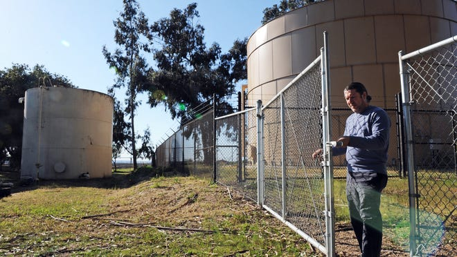 In this 2014 file photo, Horacio Amezquita, general manager of the San Jerardo Co-op, enters a water storage area.