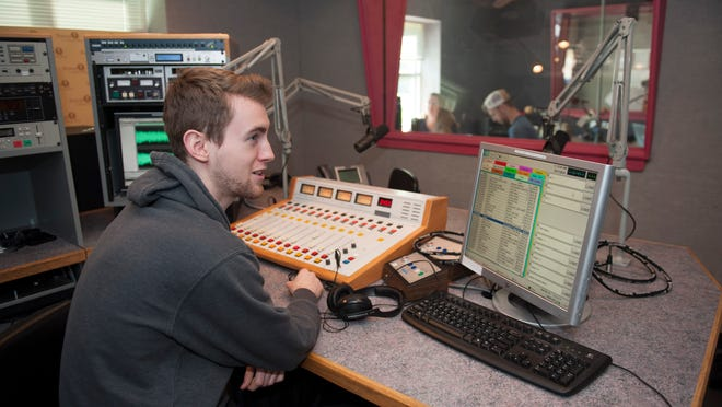 Rowan University student Ricky Schuh edits his sports podcast for Rowan Radio.