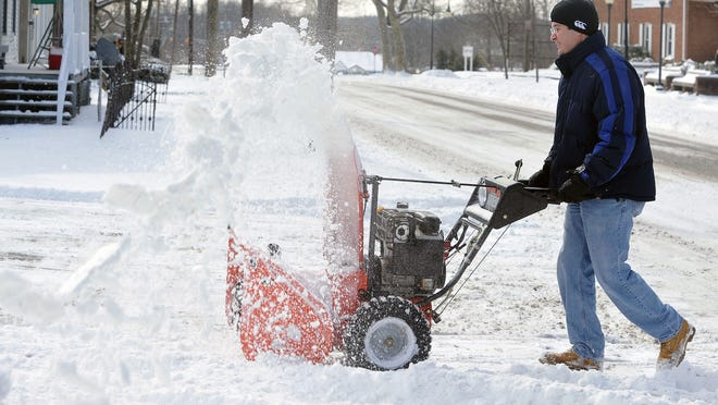 Andrew P. Van Hook of Waterfront Car Wash in Millville used a snowblower to clear out the car lanes.