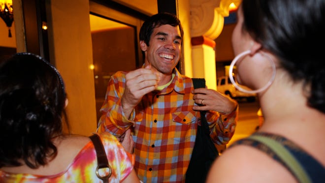 Aaron Gomes of Sound N Vision greets concert goers at the Fox Theatre for the Conor Oberst concert in 2008. His nonprofit foundation marks 10 years of bringing bands to Visalia and promoting local musicians.