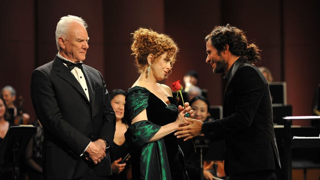 """Malcolm McDowell, left, Bernadette Peters and Gael García Bernal star in the Amazon Prime series """"Mozart in the Jungle,"""" about the lives of freelance musicians in New York City. Much of the series was shot at Purchase College, with members of the New Westchester Symphony Orchestra acting as extras."""