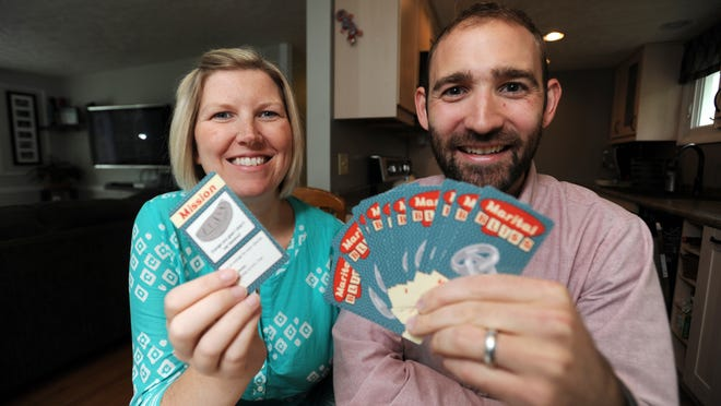 Nick and Nicole Fink, of Zanesville, created the card game Marital Bliss with the help of crowdfunding website Kickstarter.com.