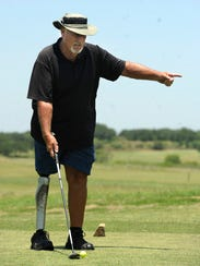 Jerry Drummond, from Manor, prepares to tee off on