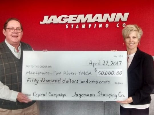 "Jagemann Stamping Company recently donated $50,000 to the Manitowoc-Two Rives YMCA Capital Campaign ""Building What Matters."" Pictured are YMCA board member John Zimmer and Jagemann Stamping Administrative Assistant Dayna Wech."