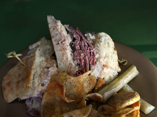 January 22, 2018 - The Pee Wee sandwich at Sunrise Memphis includes corned beef, swiss cheese, sauerkraut, 1000 island dressing on ciabatta bread and comes with ranch chips. The restaurant is located at 670 Jefferson Ave.