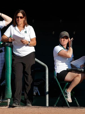 Michigan State head coach Jacquie Joseph, left, and assistant coach Jessica Bograkos watch the action against Indiana Friday, April 15, 2016, in East Lansing, Mich. Michigan State won 6-2.
