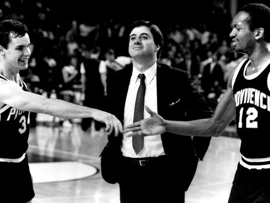 Providence coach Rick Pitino stands between Billy Donovan, left, and Delray Brooks (12) as they congratulate each other after their victory over Alabama in the regional semifinal in Louisville in 1987.