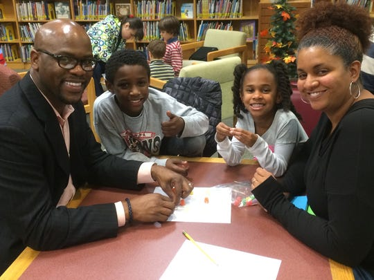 Cameron and Haven Neal, along with their parents enjoy problem solving at the Bayberry STEAM Family night