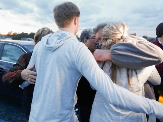 Brad Jennings hugs his family after he was released